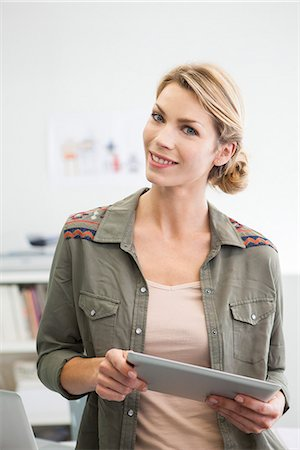 ebusiness - Woman holding digital tablet Stock Photo - Premium Royalty-Free, Code: 632-07674466