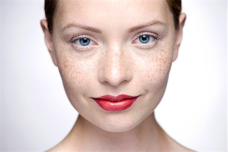 Young woman wearing red lipstick, close-up Stock Photo - Premium Royalty-Free, Code: 632-07674460