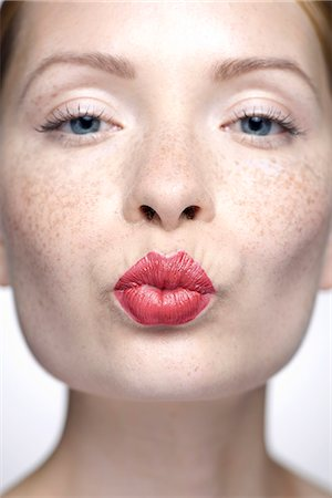pucker - Young woman with pursed lips wearing red lipstick, close-up Stock Photo - Premium Royalty-Free, Code: 632-07674461