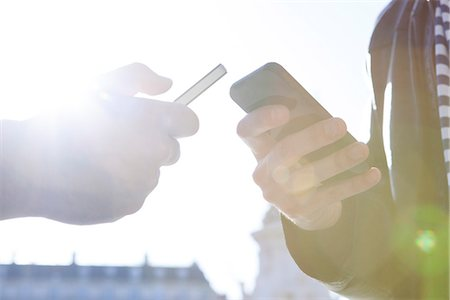 Wirelessly sharing data between smartphones Stock Photo - Premium Royalty-Free, Code: 632-07674475