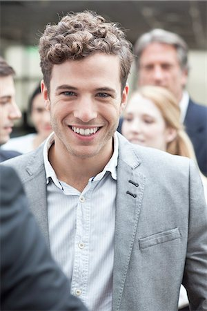 partnership - Young business associate with colleagues Stock Photo - Premium Royalty-Free, Code: 632-07674587