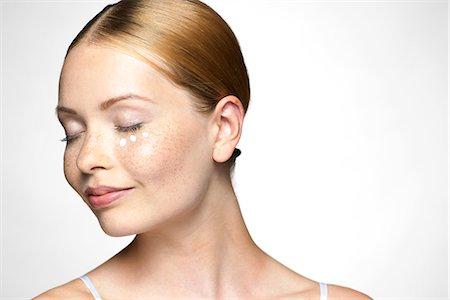 prevention - Young woman applying undereye cream Stock Photo - Premium Royalty-Free, Code: 632-07674607