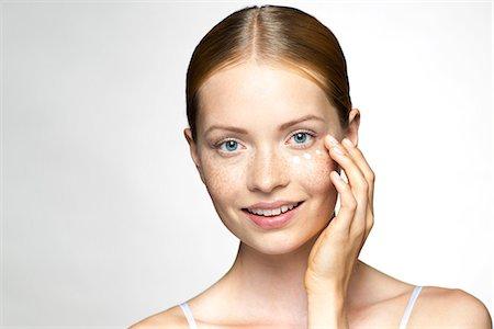 prevention - Young woman applying undereye cream Stock Photo - Premium Royalty-Free, Code: 632-07674600