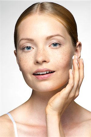 person silhouette face - Young woman applying moisturizer to face Stock Photo - Premium Royalty-Free, Code: 632-07674603