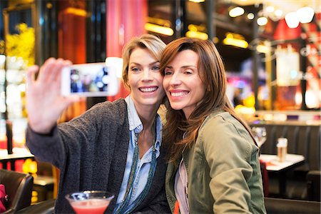 enjoying - Women in bar taking self-portrait with photophone Stock Photo - Premium Royalty-Free, Code: 632-07674611