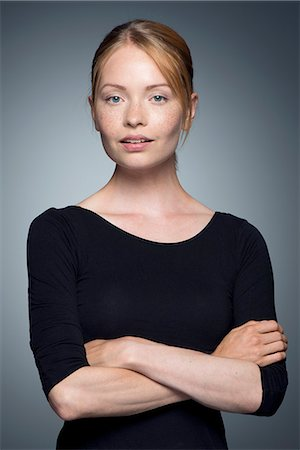 Young woman with arms folded, portrait Stock Photo - Premium Royalty-Free, Code: 632-07674654