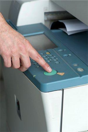 Using photocopier, close-up Stock Photo - Premium Royalty-Free, Code: 632-07674665