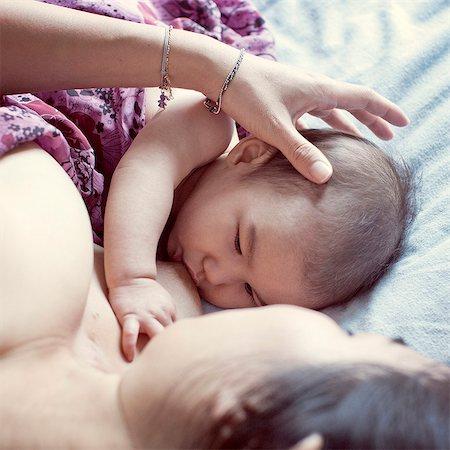Mother breastfeeding baby Stock Photo - Premium Royalty-Free, Code: 632-07674679