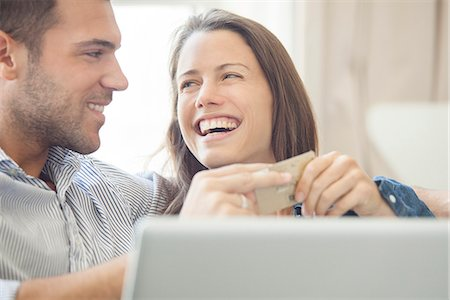 Couple at home shopping online together Stock Photo - Premium Royalty-Free, Code: 632-07674684
