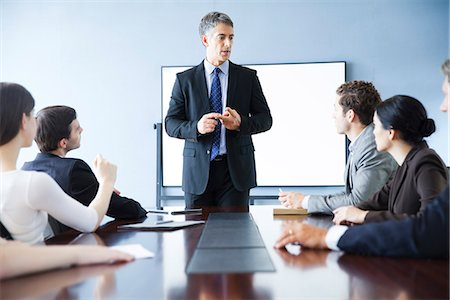 Executive making presentation at business meeting Stock Photo - Premium Royalty-Free, Code: 632-07674688