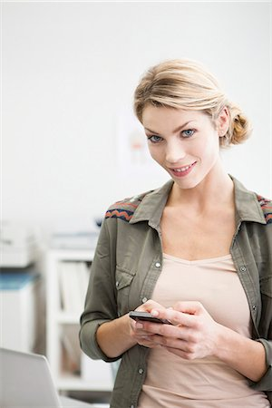 Woman holding cell phone Stock Photo - Premium Royalty-Free, Code: 632-07674698