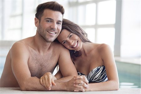 shirtless men - Young couple in pool together, portrait Stock Photo - Premium Royalty-Free, Code: 632-07674701