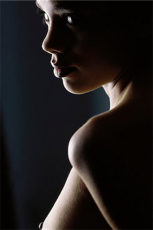 Nude woman looking over shoulder, close-up Stock Photo - Premium Royalty-Free, Code: 632-07674764