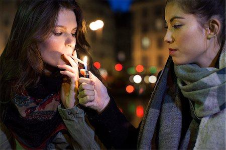 smoke - Woman lighting friend's cigarette Stock Photo - Premium Royalty-Free, Code: 632-07809357