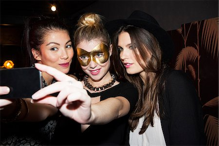 Young women at night club taking selfie Stock Photo - Premium Royalty-Free, Code: 632-07809429