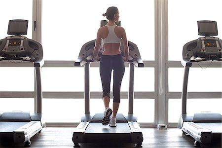 Woman jogging on treadmill at gym Stock Photo - Premium Royalty-Free, Code: 632-07809482