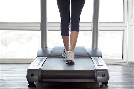 Using treadmill Stock Photo - Premium Royalty-Free, Code: 632-07809483