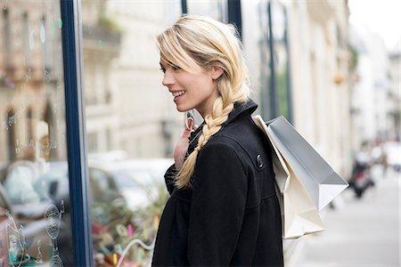 Woman window shopping Stock Photo - Premium Royalty-Free, Code: 632-07809573