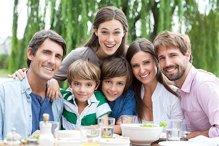 Family posing for portrait at outdoor gathering Stock Photo - Premium Royalty-Free, Code: 632-07849456
