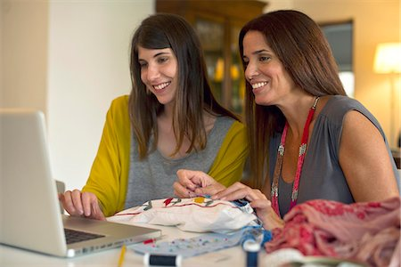 streaming - Sisters learning embroidery together by watching online videos Stock Photo - Premium Royalty-Free, Code: 632-07849532