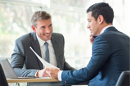 Businessmen discussing documents in meeting Stock Photo - Premium Royalty-Free, Code: 632-08001604
