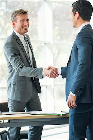 Businessmen shaking hands in office Stock Photo - Premium Royalty-Free, Code: 632-08001601