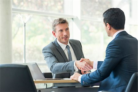 Businessmen shaking hands in meeting Stock Photo - Premium Royalty-Free, Code: 632-08001603