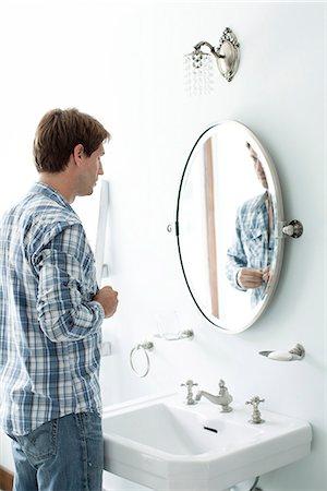 Man buttoning shirt Stock Photo - Premium Royalty-Free, Code: 632-08001816