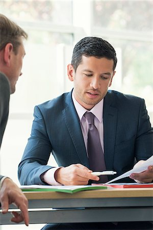 Businessman discussing contract with client Stock Photo - Premium Royalty-Free, Code: 632-08001898