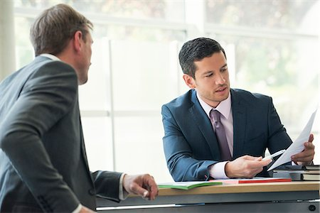 Businessmen discussing contract in meeting Stock Photo - Premium Royalty-Free, Code: 632-08001899