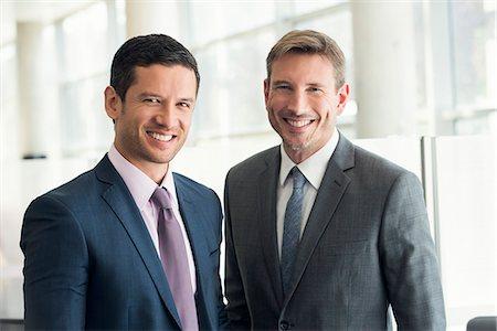 Businessmen smiling, portrait Stock Photo - Premium Royalty-Free, Code: 632-08001893