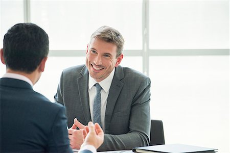 Businessman meeting with associate in office Stock Photo - Premium Royalty-Free, Code: 632-08001903