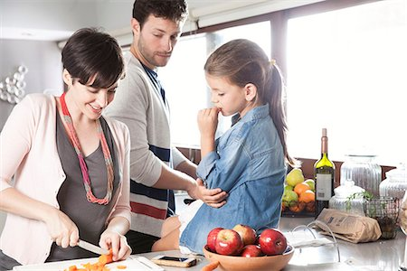 Family preparing food together in kitchen Stock Photo - Premium Royalty-Free, Code: 632-08129832