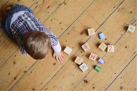 Baby boy playing with abc blocks, overhead view Stock Photo - Premium Royalty-Free, Code: 632-08129903