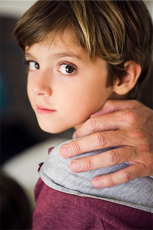Parent's hand on boy's shoulder, cropped Stock Photo - Premium Royalty-Free, Code: 632-08129913