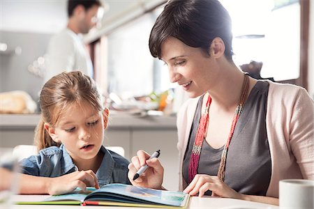 Mother and young daughter reading together Stock Photo - Premium Royalty-Free, Code: 632-08129922
