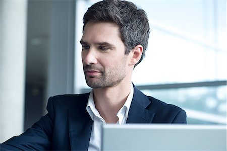 Businessman working in office Stock Photo - Premium Royalty-Free, Code: 632-08129939
