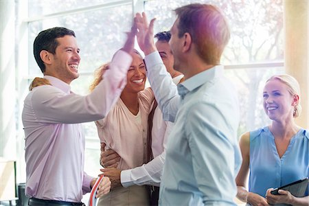 five - Colleagues giving each other high-five Stock Photo - Premium Royalty-Free, Code: 632-08130024