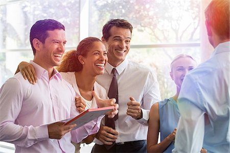 Business associates sharing lighthearted moment together Stock Photo - Premium Royalty-Free, Code: 632-08130027