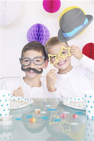 family image and confetti - Boys wearing funny disguises at birthday party Stock Photo - Premium Royalty-Free, Code: 632-08130064