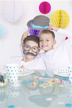 family image and confetti - Boys wearing funny disguises at birthday party Stock Photo - Premium Royalty-Free, Code: 632-08130065