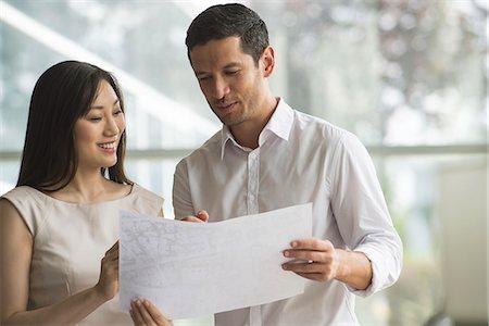 staff - Business associates collaborating Stock Photo - Premium Royalty-Free, Code: 632-08130091