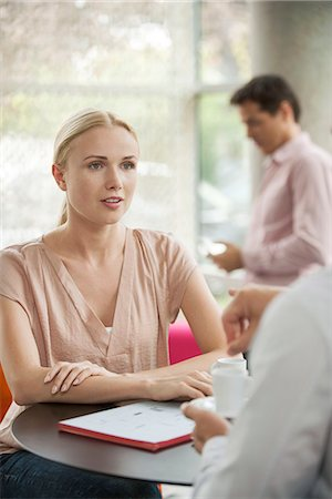 Woman meeting with colleague in cafe Stock Photo - Premium Royalty-Free, Code: 632-08130131