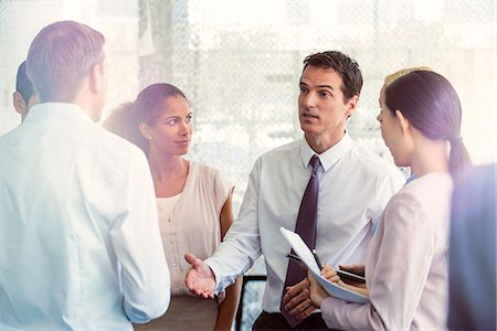 Team members receive direction from supervisor Stock Photo - Premium Royalty-Free, Code: 632-08130211
