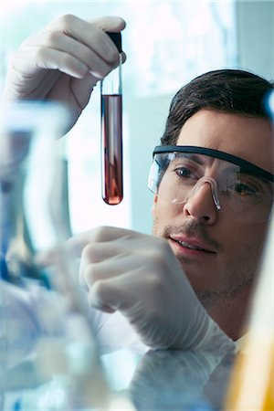 discovery - Scientist conducting experiment in laboratory Stock Photo - Premium Royalty-Free, Code: 632-08130286