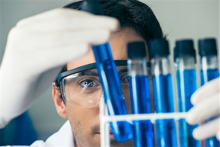 Researcher scrutinizing test tubes in laboratory Stock Photo - Premium Royalty-Free, Code: 632-08130282