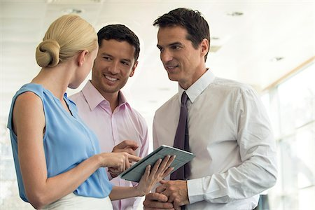 Professionals collaborating using digital tablet Stock Photo - Premium Royalty-Free, Code: 632-08130333