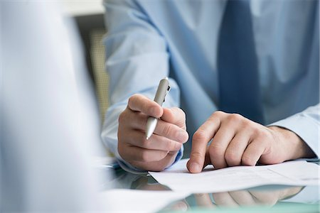 Lawyer reviewing document with client Stock Photo - Premium Royalty-Free, Code: 632-08227396