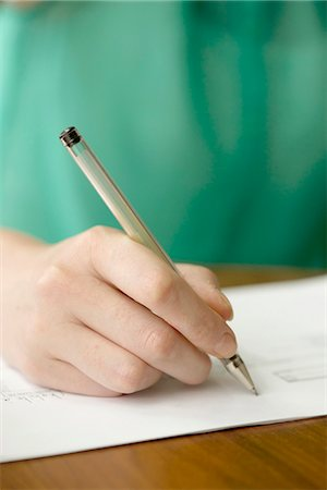 Applicant completing job application Stock Photo - Premium Royalty-Free, Code: 632-08227474