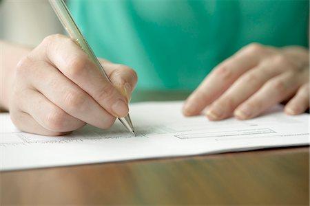 Writing letter Stock Photo - Premium Royalty-Free, Code: 632-08227475